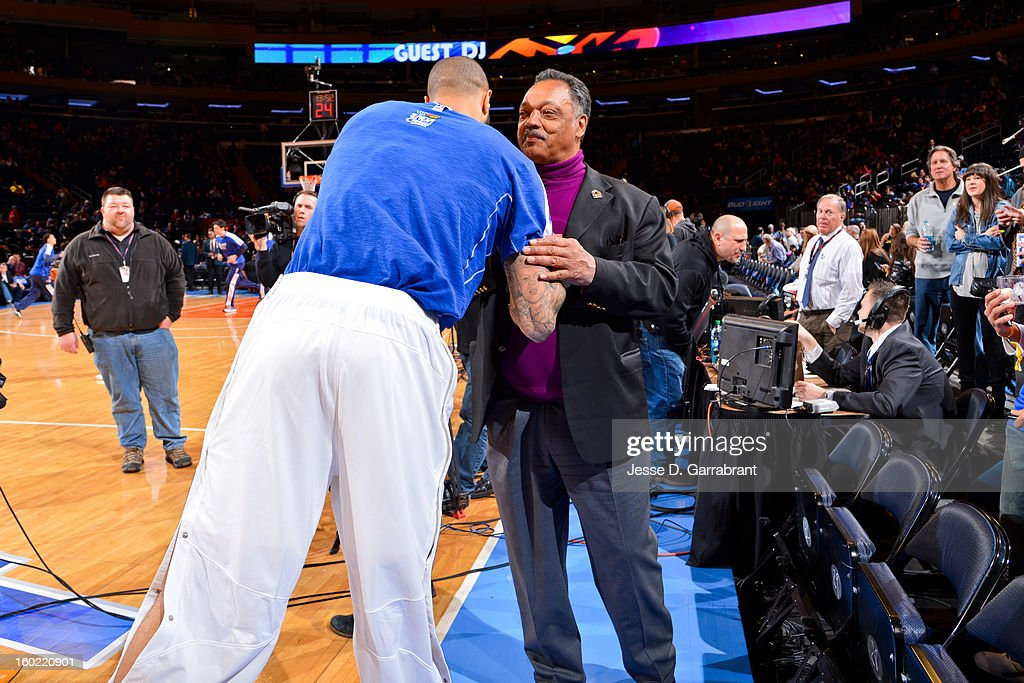 Reverend Jesse Jackson greets Tyson Chandler #6 of the New York Knicks before a game between the Atlanta Hawks and Knicks at Madison Square Garden on January 27, 2013 in New York, New York.