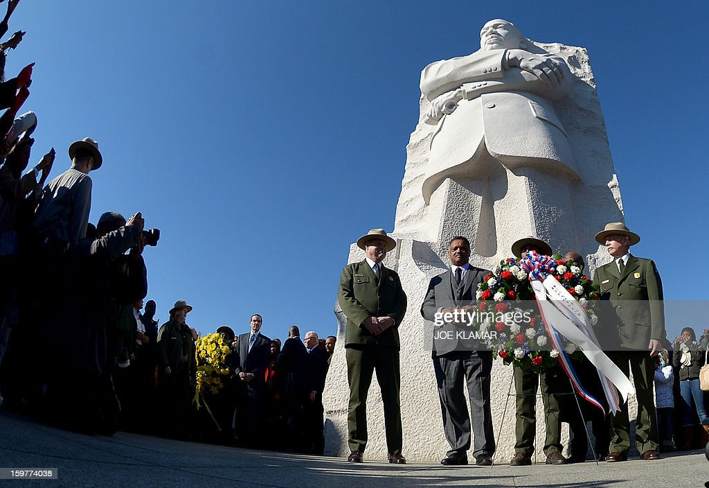 Reverend Jesse Jackson lays a wreath at the statue of civil rights leader Martin Luther King, Jr. on the occasion of Martin Luther King Day at the MLK Memorial on January 20, 2013 in Washington. King is best known for his role in the advancement of civil rights using nonviolent civil disobedience.