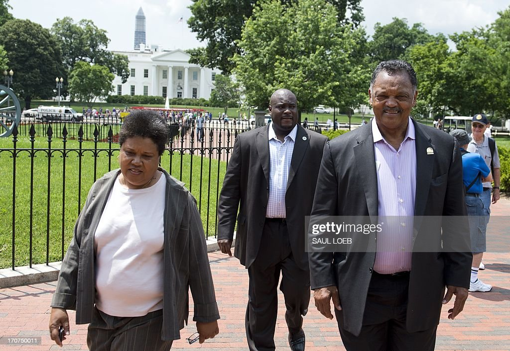 Reverend Jesse Jackson (R), leaves a rally following a protest march calling on US President Barack Obama to end the so-called 'War on Drugs,' which they say leads to mass incarceration of African Americans, as well as wanting additional investment in jobs and economic development in urban inner-city neighborhoods, during a 'Day of Direct Action' event in Lafayette Park, adjacent to the White House in Washington on June 17, 2013. AFP PHOTO / Saul LOEB
