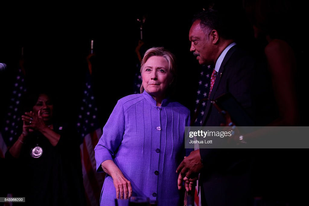 Reverend Jesse Jackson, right, speaks with Democratic presidential candidate Hillary Clinton as he delivered the keynote speech during the Rainbow PUSH Coalition's International Women's Luncheon June 27, 2016 in Chicago Illinois. Clinton addressed gun violence across the country and referred to the Orlando, Florida Pulse nightclub shooting and the uptick in gun crime across Chicago.