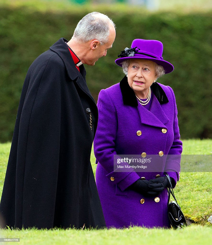Reverend Jonathan Riviere and Queen <a gi-track='captionPersonalityLinkClicked' href=/galleries/search?phrase=Elizabeth+II&family=editorial&specificpeople=67226 ng-click='$event.stopPropagation()'>Elizabeth II</a> arrive at the church of St Peter and St Paul in West Newton to attend Sunday service on February 03, 2013 near King's Lynn, England.