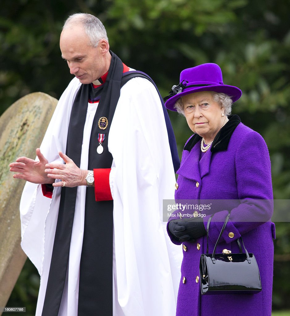 Reverend Jonathan Riviere and Queen <a gi-track='captionPersonalityLinkClicked' href=/galleries/search?phrase=Elizabeth+II&family=editorial&specificpeople=67226 ng-click='$event.stopPropagation()'>Elizabeth II</a> leave the church of St Peter and St Paul in West Newton after attending Sunday service on February 03, 2013 near King's Lynn, England.
