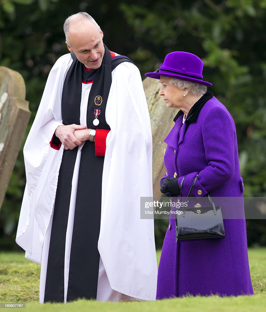 Reverend Jonathan Riviere and Queen Elizabeth II leave the church of St Peter and St Paul in West Newton after attending Sunday service on February 03, 2013 near King's Lynn, England.