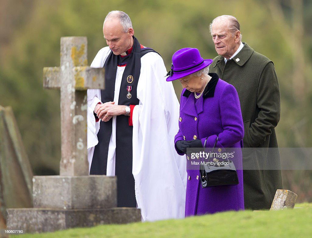 Reverend Jonathan Riviere, Queen <a gi-track='captionPersonalityLinkClicked' href=/galleries/search?phrase=Elizabeth+II&family=editorial&specificpeople=67226 ng-click='$event.stopPropagation()'>Elizabeth II</a> and <a gi-track='captionPersonalityLinkClicked' href=/galleries/search?phrase=Prince+Philip&family=editorial&specificpeople=92394 ng-click='$event.stopPropagation()'>Prince Philip</a>, Duke of Edinburgh leave the church of St Peter and St Paul in West Newton after attending Sunday service on February 03, 2013 near King's Lynn, England.