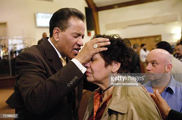 Reverend Luciano Padilla of the Bay Ridge Christian Center Pentecostal Church gives a blessing to a women on April 10 2005 in Brooklyn New York city...