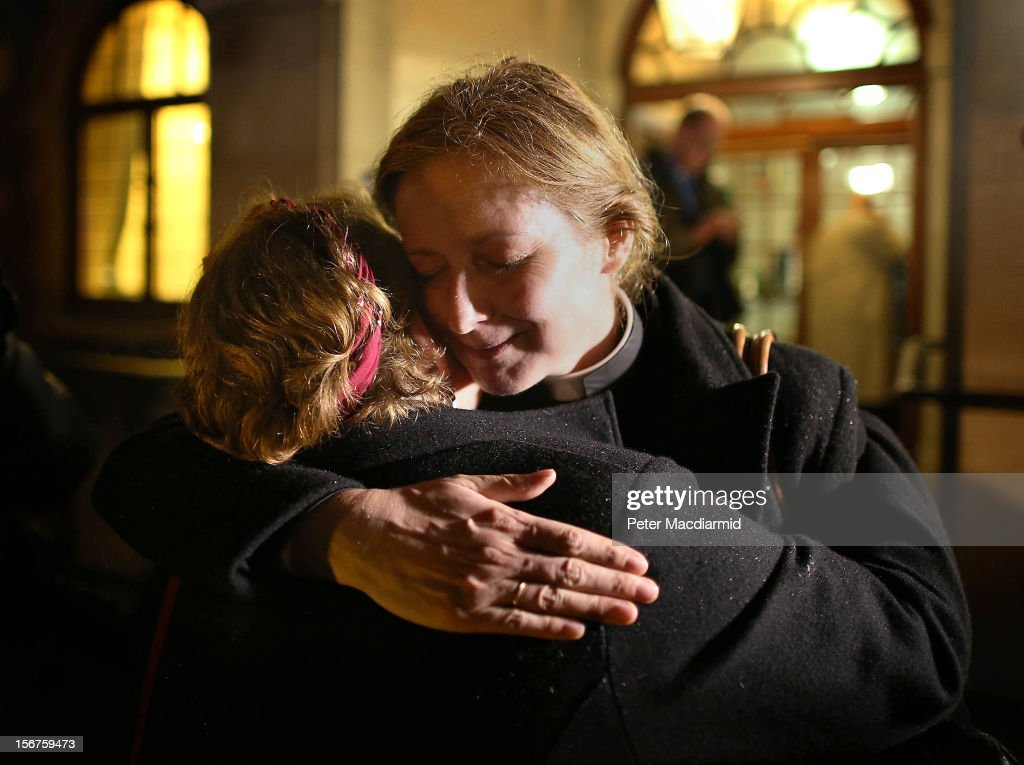 Reverend Marie-Elsa Bragg (R) hugs Reverend Angie Nutt after leaving Church House on November 20, 2012 in London, England. The Church of England's governing body, known as the General Synod, has voted against allowing women to become bishops.