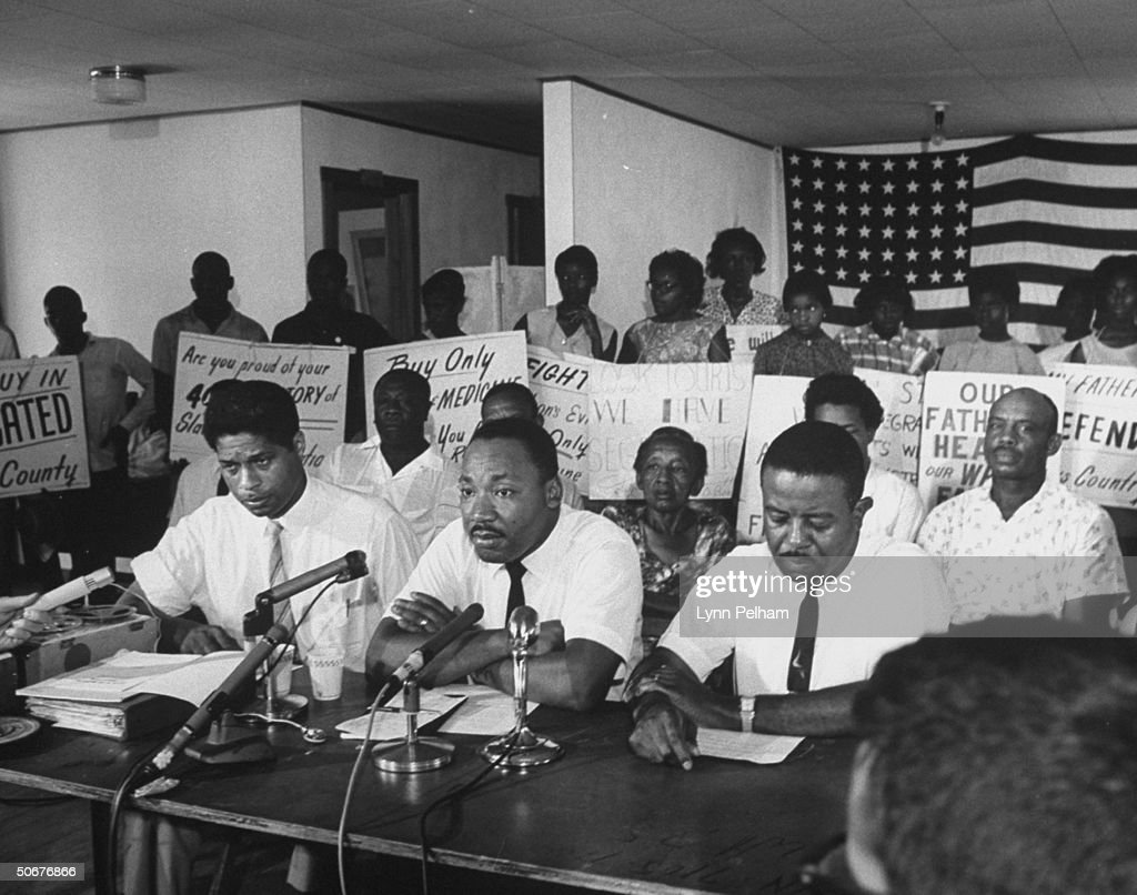 Reverend Martin Luther King, Jr. (C), during the racial problems in Florida.