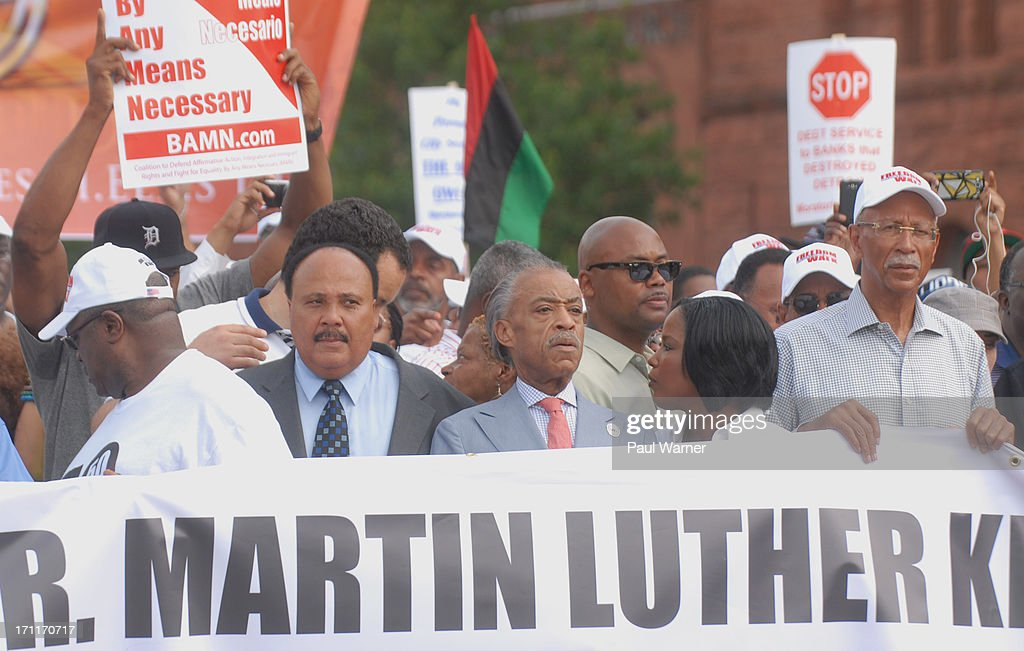 Reverend Martin Luther King Jr's son Martin Luther King III, Reverend Al Sharpton and Detroit Mayor Dave Bing march during the 50th Anniversary Freedom March on June 22, 2013 in Detroit, Michigan.