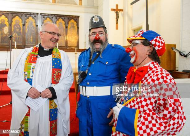 Reverend Martin Poole speaks to clowns at the annual service in memory of celebrated clown Joseph Grimaldi at the Holy Trinity Church in Dalston east...