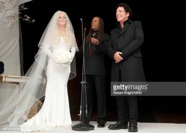 Reverend Michael Beckwith officiates the wedding of Michaele Schon and Neal Schon at the Palace of Fine Arts on December 15 2013 in San Francisco...
