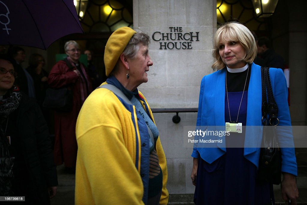 Reverend Rosie Harper (R) talks outside Church House on November 20, 2012 in London, England. The Church of England's governing body, known as the General Synod, will later today vote on whether to allow women to become bishops.