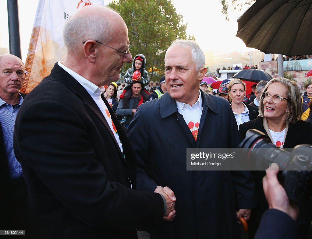 Reverend Tim Costello and Prime Minister Malcom Turnbull (R) shake hands during The Long Walk before the round 10 AFL match between the Essendon Bombers and the Richmond Tigers at Melbourne Cricket Ground on May 28, 2016 in Melbourne, Australia. The Long Walk raises awareness for Indigenous Rights affairs.