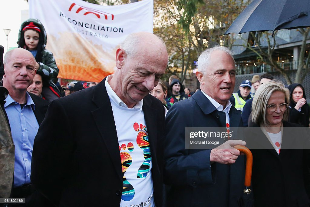 Reverend Tim Costello and Prime Minister Malcom Turnbull (R) walk together during The Long Walk before the round 10 AFL match between the Essendon Bombers and the Richmond Tigers at Melbourne Cricket Ground on May 28, 2016 in Melbourne, Australia. The Long Walk raises awareness for Indigenous Rights affairs.