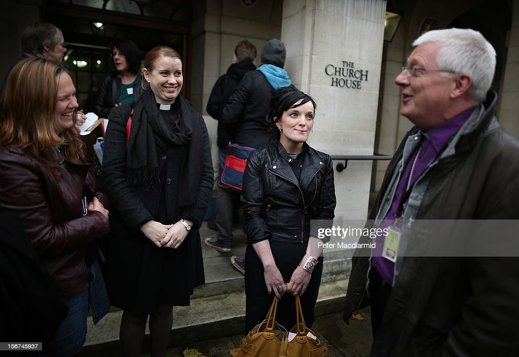 Reverends (L-R) Jody Stowell, Nicola Shephard and Sally Hitchiner talk with Peter Broadbent, The Bishop of Willesden outside Church House during a lunch break on November 20, 2012 in London, England. The Church of England's governing body, known as the General Synod, will later today vote on whether to allow women to become bishops.