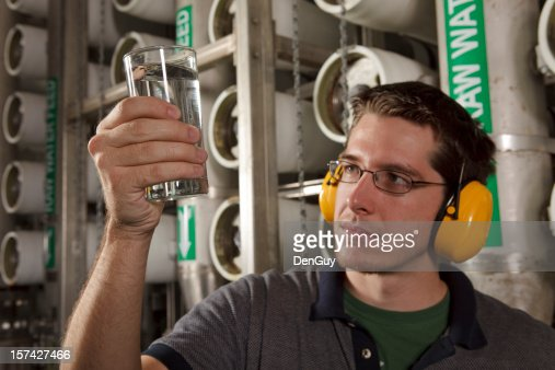 Reverse Osmosis Water Purification Plant Technician Inspects Quality