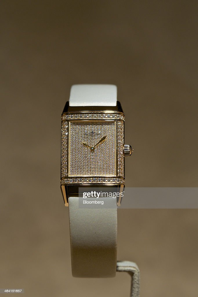 A Reverso Duetto Classique luxury wristwatch, manufactured by Jaeger-LeCoultre, a watchmaking unit of Cie. Financiere Richemont SA, sits on display at the Salon International de la Haute Horlogerie (SIHH) watch fair in Geneva, Switzerland, on Monday, Jan. 20, 2014. Enthusiasts coveting $50,000 Cartier watches at the Swiss industry's annual fair bumped opening meetings to resolve the three-year-old Syrian civil war out of the lakeside town. Photographer: Gianluca Colla/Bloomberg via Getty Images