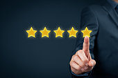 Review, increase rating or ranking, evaluation and classification concept. Businessman click on five yellow stars to increase rating of his company.'n