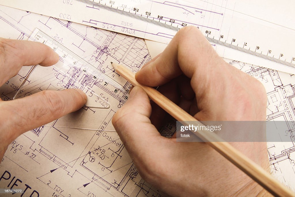 Reviewing a blueprint : Stock Photo