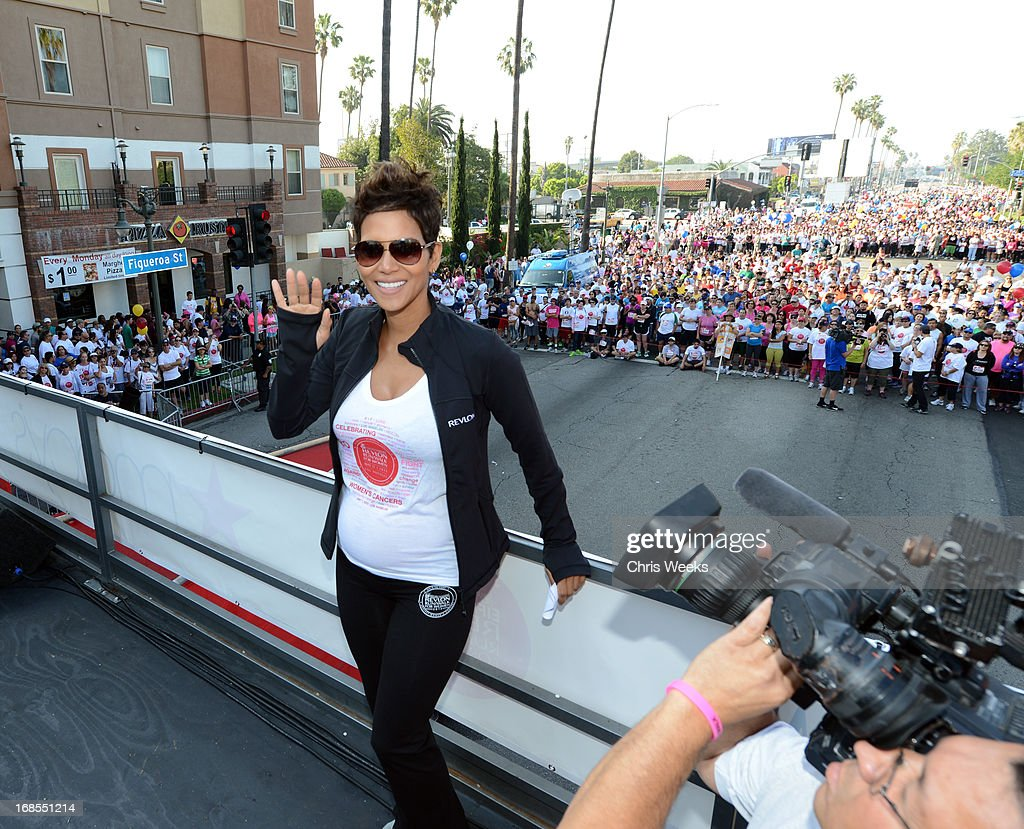 Revlon brand ambassador <a gi-track='captionPersonalityLinkClicked' href=/galleries/search?phrase=Halle+Berry&family=editorial&specificpeople=201726 ng-click='$event.stopPropagation()'>Halle Berry</a> attends the 20th Annual EIF Revlon Run/Walk For Women at Los Angeles Memorial Coliseum on May 11, 2013 in Los Angeles, California.