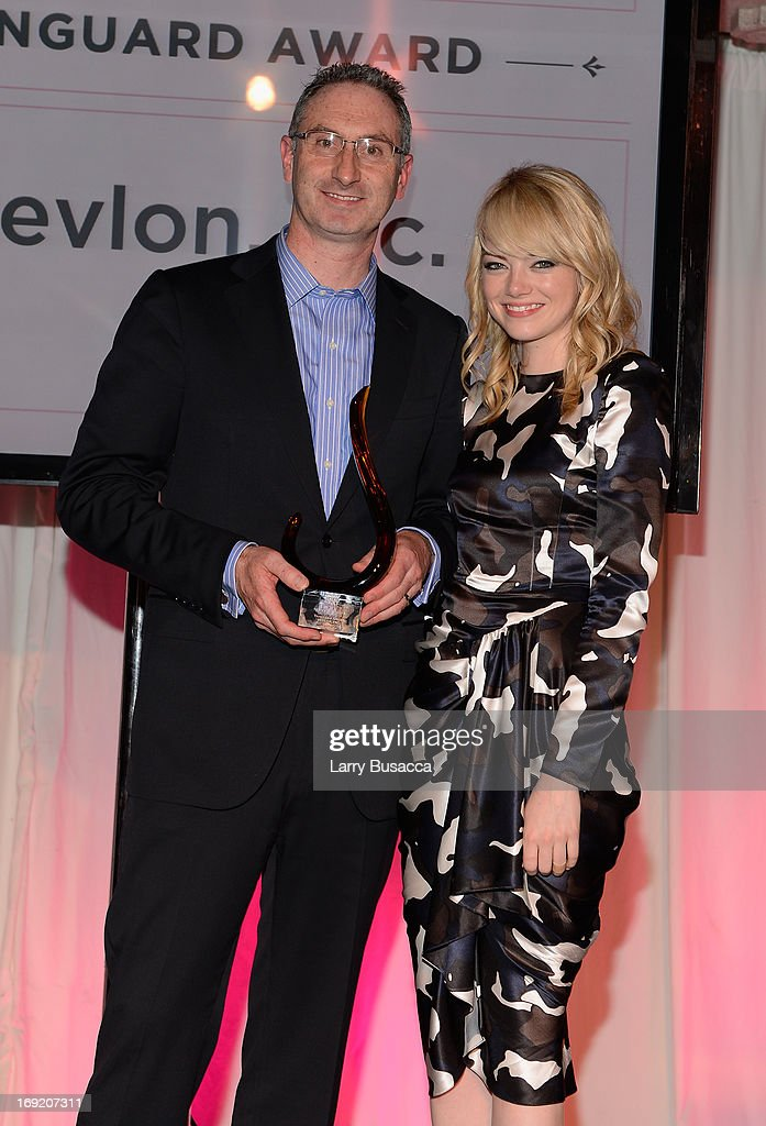 Revlon President and CEO Alan Ennis (L) and Emma Stone attend the 2013 Peace, Love & A Cure Triple Negative Breast Cancer Foundation Benefit on May 21, 2013 in Cresskill, New Jersey.