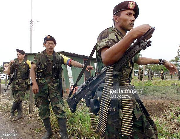 Revolutionary Armed Forces of Colombia guerrillas guard the location of talks between Manuel Marulanda Marxist rebel chief of the FARC and Colombian...