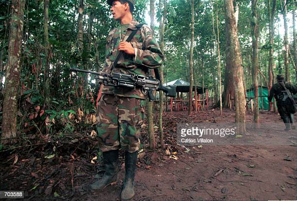 Revolutionary Armed Forces of Colombia guerrillas prepare weaponry inside their camp before leaving to set up road blockades February 28 2002 in...