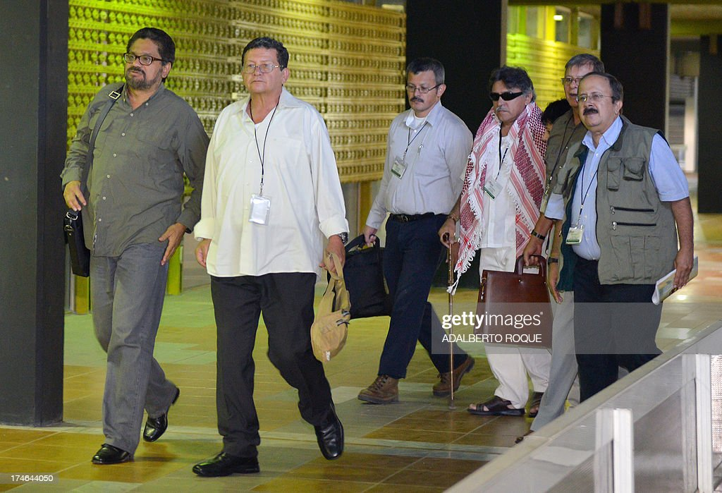 Revolutionary Armed Forces of Colombia (FARC) members Ivan Marquez, Pablo Catatumbo, Yuri Camargo, Jesus Santrich, Rodrigo Granda and Andres Paris arrive to the Convention Palace, in Havana on July 28, 2013, to attend the 12th round of peace talks with the Colombian government's delegation. Colombia will not agree to a ceasefire with FARC rebels until a five-point agenda had been agreed, the Colombian President Juan Manuel Santos stressed Saturday ahead of a resumption of peace talks.
