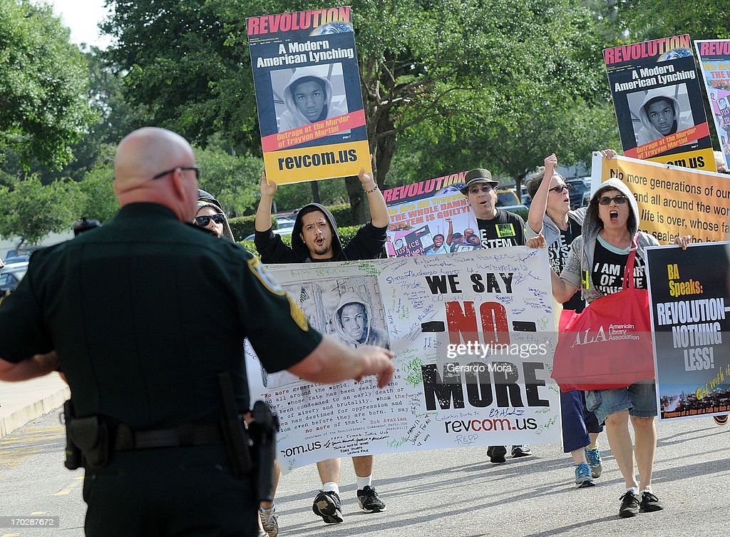 Revolutionary Communist Party members protest outside the Seminole County Courthouse during the first day of trail for George Zimmerman on June 10, 2013 in Sanford, Florida. Jury selection will begin today as Zimmerman is charged with the second-degree murder of an unarmed teenager, Trayvon Martin.