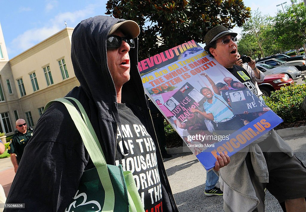 Revolutionary Communist Party members protest outside the Seminole County Courthouse during the first day of trial for George Zimmerman on June 10, 2013 in Sanford, Florida. Jury selection will begin today as Zimmerman is charged with the second-degree murder of an unarmed teenager, Trayvon Martin.