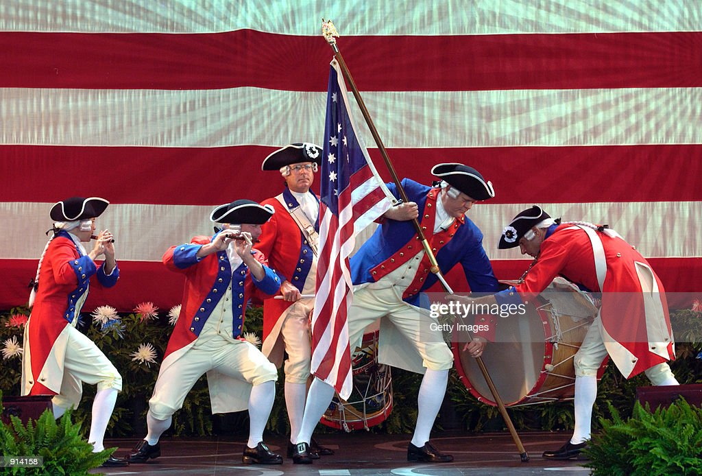 Revolutionaryera characters portray the planting of the flag at Iwo Jima before a naturalization ceremony at Epcot in Walt Disney World July 4 2002...