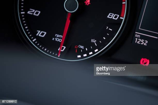 A revolutions per minute counter and compressed natural gas tank gauge sit on the dashboard of a SEAT Ibiza TGI hybrid automobile during the...