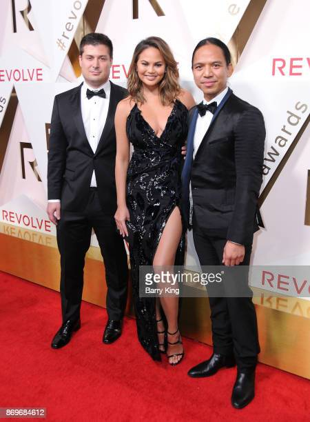 Revolve CEO Mike Karanikolas model/honoree Chrissy Teigen and Revolve CEO Michael Mente attend #REVOLVEawards at DREAM Hollywood on November 2 2017...