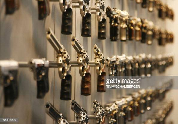 Revolvers and pistols are on display at the weapons trade fair in the southern German city of Nuremberg on March 13 2009 A heated debate on gun...