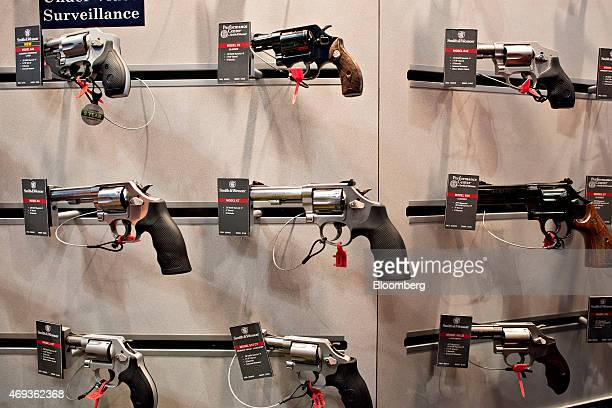 Revolvers sit on display in the Smith Wesson booth on the exhibition floor of the 144th National Rifle Association Annual Meetings and Exhibits at...