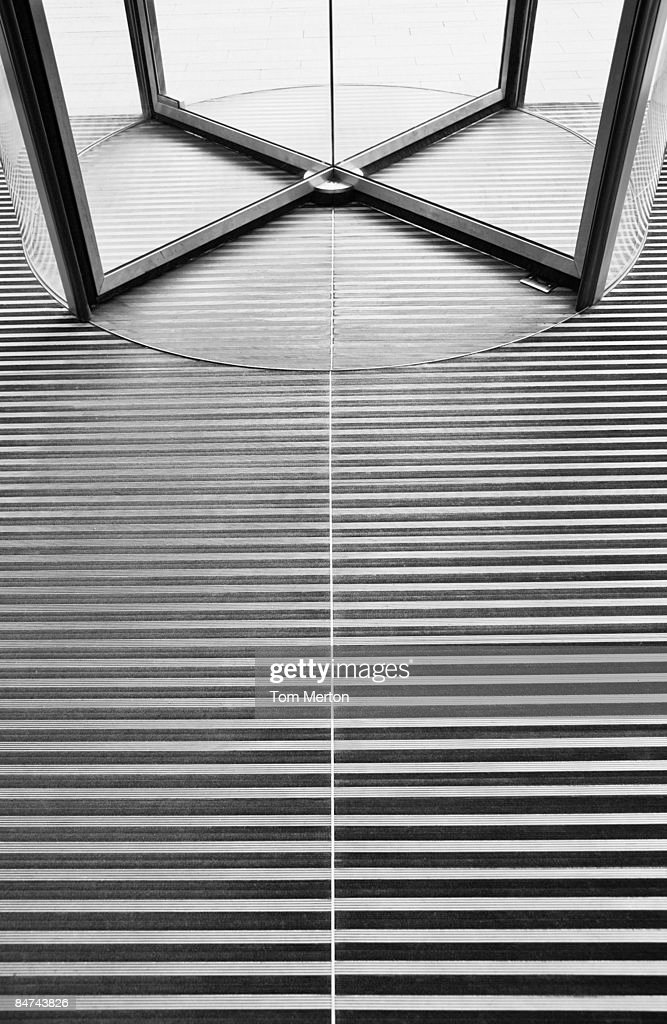 Revolving door and floor : Stock Photo