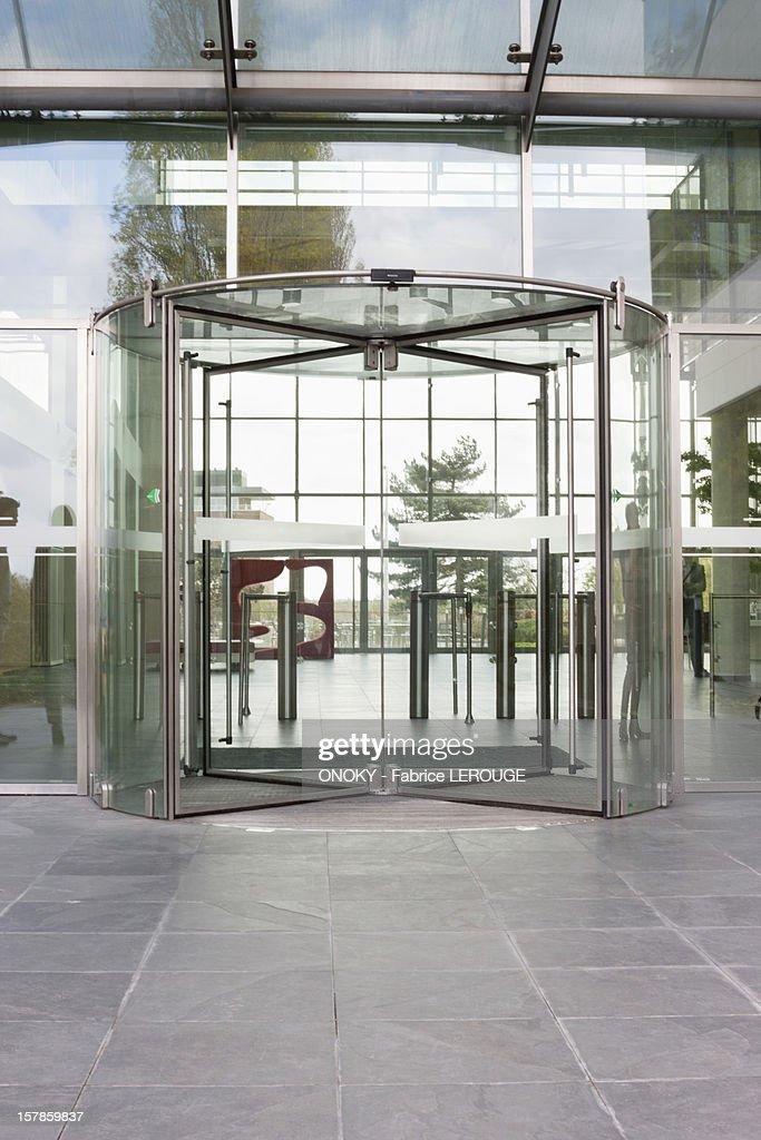 Revolving door of an office building : Stock Photo