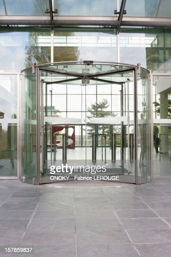 Revolving door of an office building : Stock Photo