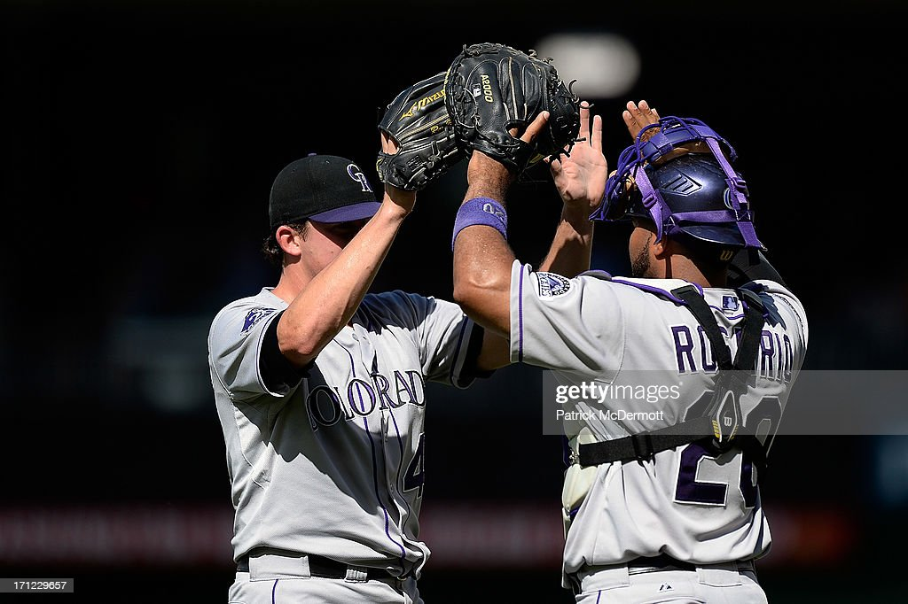 Rex Brothers #49 of the Colorado Rockies celebrates with <a gi-track='captionPersonalityLinkClicked' href=/galleries/search?phrase=Wilin+Rosario&family=editorial&specificpeople=5734314 ng-click='$event.stopPropagation()'>Wilin Rosario</a> #20 after the Rockies defeated the Washington Nationals 7-6 during a game at Nationals Park on June 23, 2013 in Washington, DC.