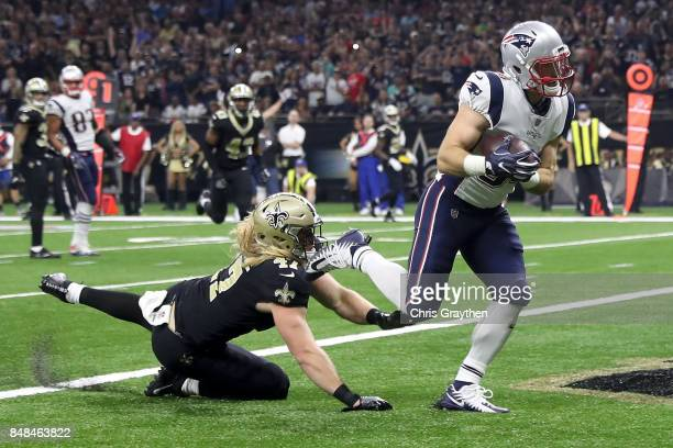 Rex Burkhead of the New England Patriots scores a touchdown over Alex Anzalone of the New Orleans Saints at the MercedesBenz Superdome on September...