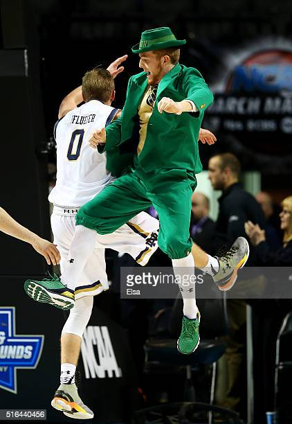 Rex Pflueger of the Notre Dame Fighting Irish celebrates their 7063 win over the Michigan Wolverines during the first round of the 2016 NCAA Men's...