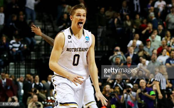 Rex Pflueger of the Notre Dame Fighting Irish reacts after tipping in a shot to defeat the Stephen F Austin Lumberjacks 76 to 75 in the second half...