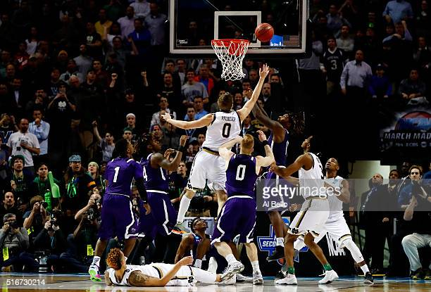 Rex Pflueger of the Notre Dame Fighting Irish tips in Stephen F Austin Lumberjacks shot to defeat the Stephen F Austin Lumberjacks 76 to 75 in the...