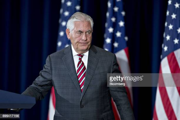 Rex Tillerson US secretary of State exits after a news conference following the inaugural USChina Diplomatic and Security Dialogue meeting with James...