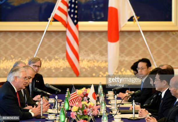 Rex Tillerson US Secretary of State left and Fumio Kishida Japan's foreign minister second right attend a bilateral meeting in Tokyo Japan on...