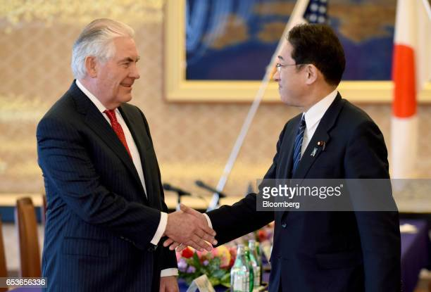 Rex Tillerson US Secretary of State left shakes hands with Fumio Kishida Japan's foreign minister ahead of a bilateral meeting in Tokyo Japan on...