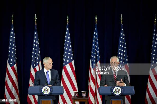 Rex Tillerson US secretary of State right speaks as James Mattis US secretary of defense listens during a news conference following the inaugural...
