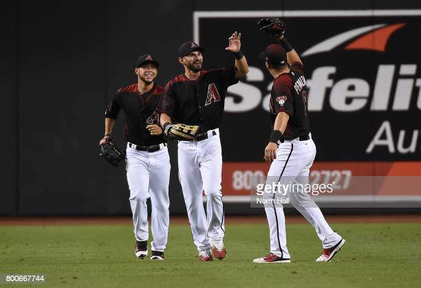 Rey Fuentes of the Arizona Diamondbacks and teammates David Peralta and Gregor Blanco celebrate a 92 win against the Philadelphia Phillies at Chase...