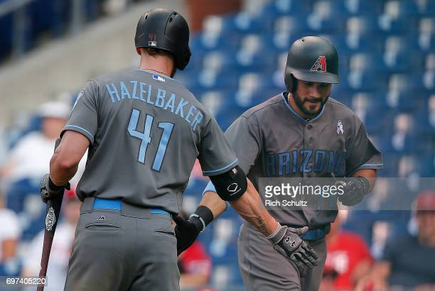 Rey Fuentes of the Arizona Diamondbacks is congratulated by Jeremy Hazelbaker after he hit the eventual game winning home run against the...