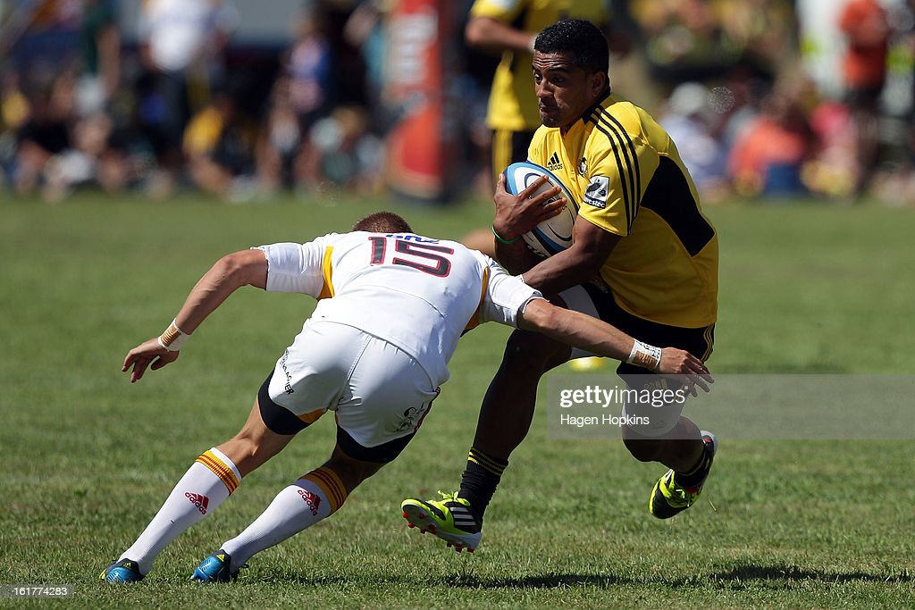 Rey LeeLo of the Hurricanes is tackled by Gareth Anscombe of the Chiefs during the Super Rugby trial match between the Hurricanes and the Chiefs at Mangatainoka RFC on February 16, 2013 in Mangatainoka, New Zealand.