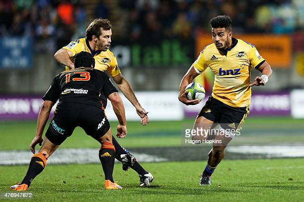 Rey LeeLo of the Hurricanes runs the ball with Conrad Smith in support during the round 18 Super Rugby match between the Chiefs and the Hurricanes at...